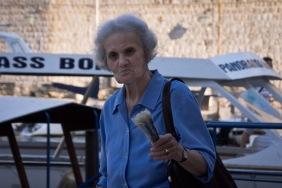 When I held up my camera at this woman on the docks of Dubrovnik, she pointed right at me and smiled.